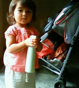 Little Girl Holding Spray Bottle
