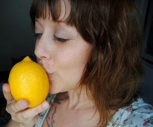 Picture of lady kissing lemon.