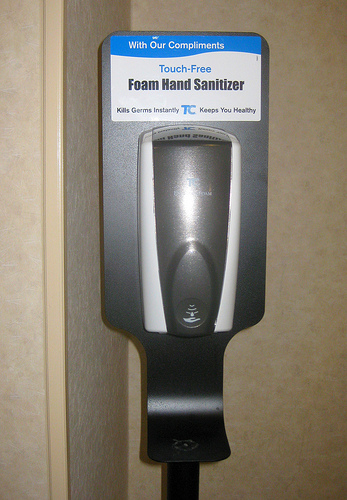 Hand sanitizer's in a building's lobby.